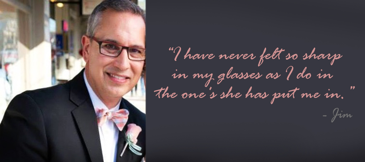 man wearing a tuxedo and maroon glasses